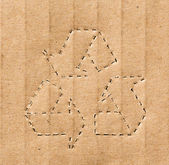 Recycling symbol on the carton background — Photo