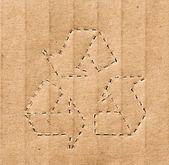 Recycling-Symbol auf dem Karton-Hintergrund — Stockfoto