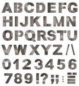 Jest pełne starych metalowych alfabetu liter, cyfr i znaków interpunkcyjnych — Zdjęcie stockowe