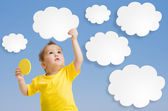 Kid or child keep cloud and sun in his hands — Stock Photo