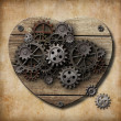 Aged human heart model made of rusty metal gears — Stock Photo