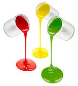Pouring colorful paints isolated on white — Stock Photo