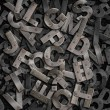 Heap of old rusty metal letters background — Stock Photo