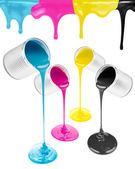 Magenta, cyan, yellow and black liquid paints isolated — Stock Photo