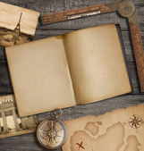 Open diary top view with old treasure map and compass — 图库照片