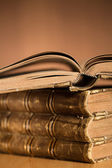 Old vintage books on the table cropped with free space for your — Stock Photo