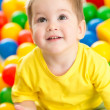 Cute kid or child playing colorful balls top view — Stock Photo #23458562