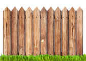 Wooden fence and grass isolated on white — Stock Photo