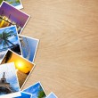 Traveling photos on wooden background — Stock Photo #23534125