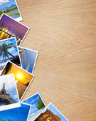 Traveling photos on wooden background — Stock Photo