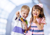 Children with icecream cone in abstract cafe — Stok fotoğraf
