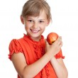 Girl eating red apple isolated — Stock Photo #24078071