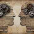 Two human head silhouettes with cogs and gears — Foto de Stock
