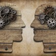 Stock Photo: Two human head silhouettes with cogs and gears