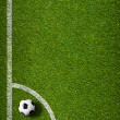 Soccer ball in corner kick position. Football field top view. — Stock Photo #24581841