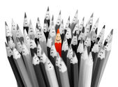 En ljus färg leende penna bland massa grå trist pennor — Stockfoto