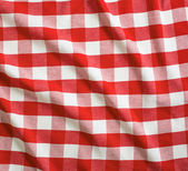 Red and white linen tablecloth — Stock Photo