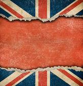Bandeira britânica grunge no papel rasgado com um grande espaço vazio — Foto Stock