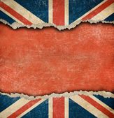 Grunge British flag on ripped paper with big empty space — Stockfoto