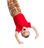 Kid boy upside down isolated on white — Stock Photo
