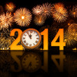 Stock Photo: 2014 year with fireworks and clock displaying 5 minutes before m
