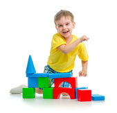 Happy kid playing with colorful blocks isolated — Stock Photo