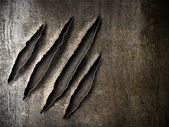 Claws scratches marks on rusty metal plate — Stock Photo