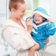 Happy mother and child teeth brushing together in bathroom — Stock Photo #27347471