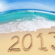 Wide angle shot of beach with blue sky and 2013 year digits — Stock Photo #27397327