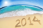 Wide angle shot of beach with blue sky and 2014 year digits — Stock Photo