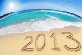 Wide angle shot of beach with blue sky and 2013 year digits — Stock Photo