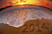 Nuevo año 2014 dígitos en sunset beach ocean — Foto de Stock