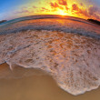 Wide angle shot of beach on sunset — Stock Photo