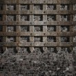 Medieval old metal lattice on stone wall — Stock Photo