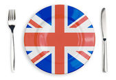 British flag plate, fork and knife top view isolated — Stock Photo