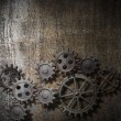 Metal background with rusty gears and cogs — Stock Photo
