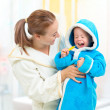 Stock Photo: Dental hygiene in bathroom. Mother and child cleaning teeth toge