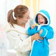 Dental hygiene in bathroom. Mother and child cleaning teeth toge — Stock Photo