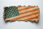 USA flag on cardboard piece — Stock Photo