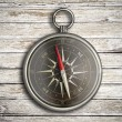 Vintage compass over wood background — Stock Photo