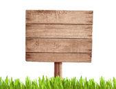 Oude leeg hout verkeersbord met gras — Stockfoto