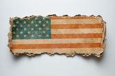 USA flag on torn cardboard — Stock Photo