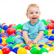 Happy kid playing colorful balls — Stock Photo #28446823
