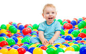 Happy kid playing colorful balls — Stock Photo