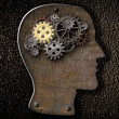 Stock Photo: Brain mechanism gears and cogs made from rusty metal