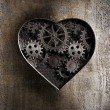 Metal heart with rusty gears and cogs — Stock Photo #31147395