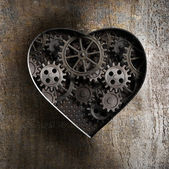 Metal heart with rusty gears and cogs — Stock Photo