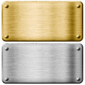 Silver and gold metal plates isolated — Stock Photo