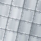 Armoured metal background with rivets — Stock Photo