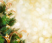 Golden Christmas tree background — Stock Photo